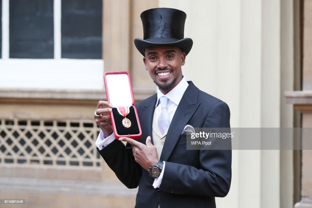Four-time Olympic champion Sir Mo Farah poses after receiving his knighthood from Queen Elizabeth II at Buckingham Palace on November 14, 2017 in London, United Kingdom.