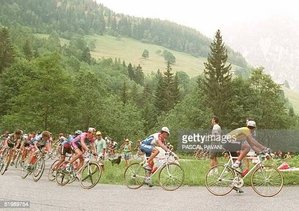 Fourtime winner of the Tour de France and current yellow jersey holder Miguel Indurain of Spain leads the pack during the 9th stage of the French...