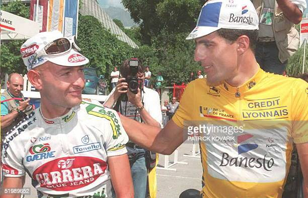 Fourtime winner of the Tour de France and yellow jersey Miguel Indurain of Spain congratulates Marco Pantani of Italy 13 July in Bourg d'Oisans...