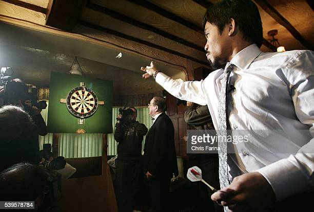 Fourtime world champion Manny 'Pacman' Pacquiao General SantosPhilippines and Ricky 'The Hitman' HattonManchesterEngland throw a friendly game of...