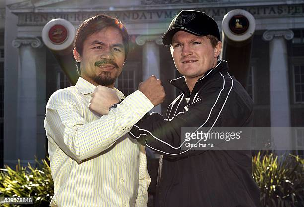 Fourtime world champion Manny 'Pacman' Pacquiao General SantosPhilippines and Ricky 'The Hitman' HattonManchesterEngland pose in front of the giant...