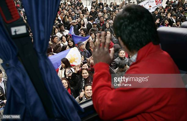 Fourtime world champion Manny Pacman Pacquiao General Santos Philippines is greeted by hundreds of fans as he attends Westminster Cathedral the...