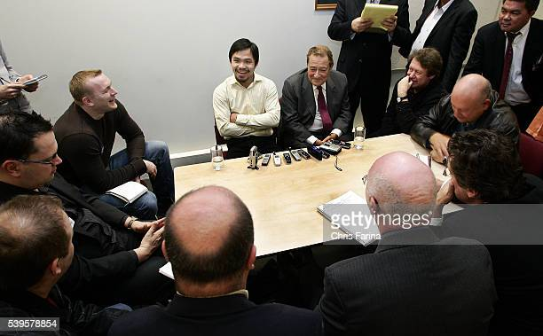 Fourtime world champion Manny 'Pacman' Pacquiao General SantosPhilippines speaks to reporters as Hall of Fame Top Rank promoter Bob Arum looks on...