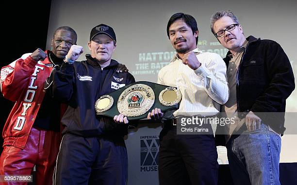 Fourtime world champion Manny Pacman PacquiaoGeneral SantosPhilippines and Ricky The Hitman HattonManchesterEngland pose with their trainers Floyd...