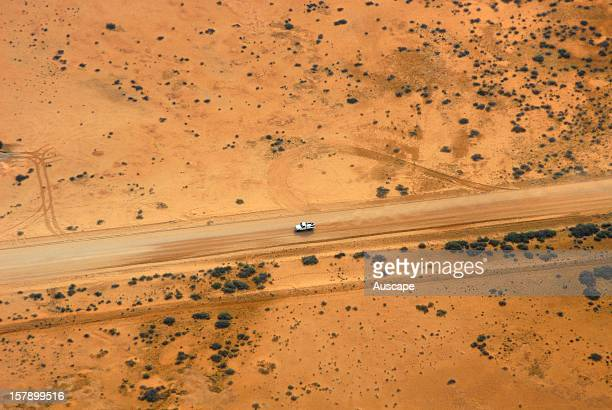 A fourwheel drive vehicle on the Birdville track from the air Lake Eyre Basin norththeast South Australia