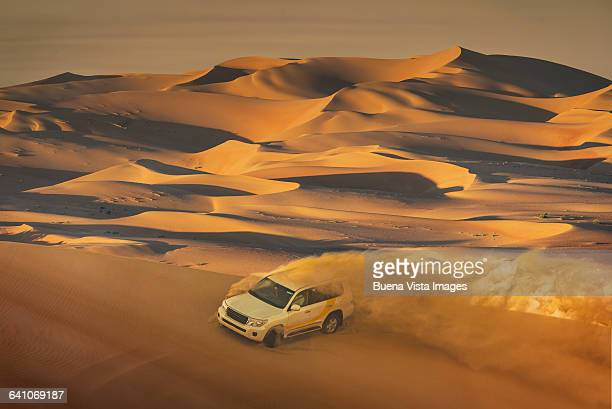 Four-wheel-drive vehicle in the desert