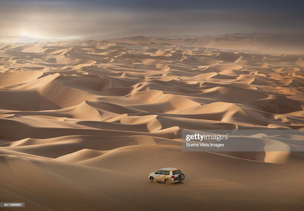 Four-wheel-drive vehicle in the desert : Stock Photo