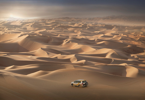 Four-wheel-drive vehicle in the desert - gettyimageskorea
