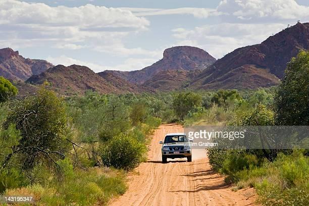Fourwheeldrive vehicle on the MereenieWatarrka Road Gosse Bluff Red Centre Australia