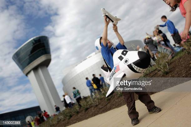 Fouryearold Alex Mendez of Sterling VA wears a space shuttle costume while he waits with thousands of others for the arrival of the space shuttle...