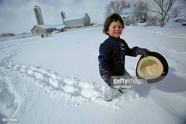 Fouryearold Amish boy Elemer Stoltzfus plays in the snow during a day off from school due to the overnight snowstorm March 2 2009 in St Mary's County...