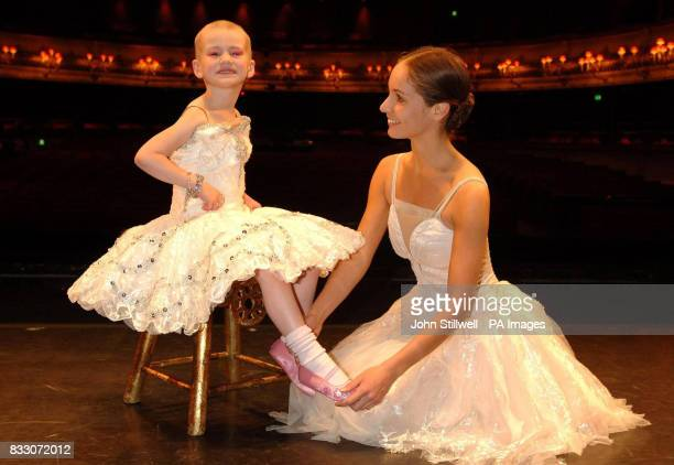 Fouryearold Angelina Vidler of Shoeburyness Essex has her shoes adjusted by prima ballerina Francesca Filpi as she fulfils her dream of being a...