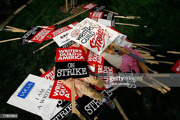 Fouryearold Beau StaunList and eightyearold Soleil StaunSnyder whose father Steven List is a striking writer play in a pile of strike signs as more...