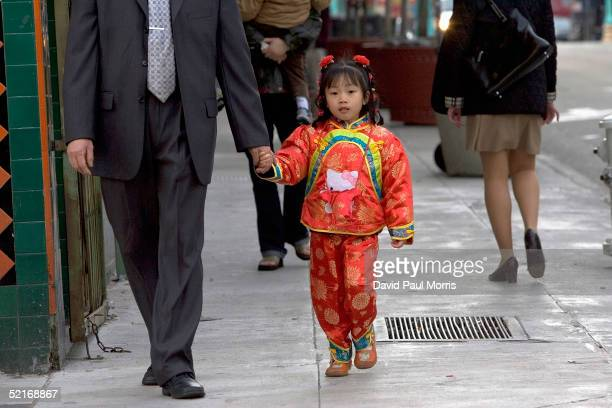 Fouryearold Bella Chen walks down Stockton Street during a celebration of the Chinese New Year in Chinatown February 9 2005 in San Francisco...