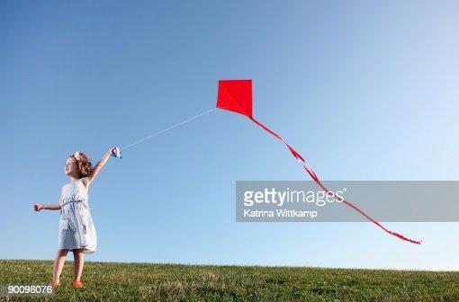 fouryearold girl flying red kite stock photo
