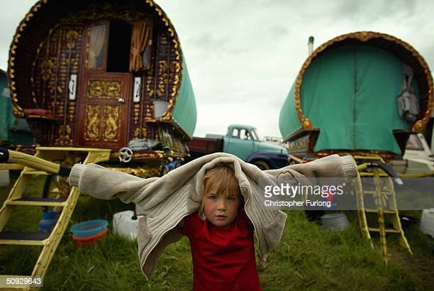 Fouryearold gypsy girl Loren Gaskin plays next to her family's caravan at Appleby Horse Fair June 5 2004 in Appleby England Appleby Horse Fair has...