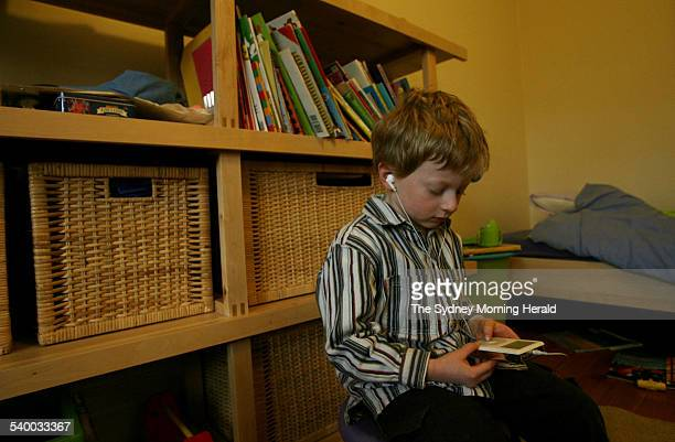 Fouryearold Isaac Sharwood in his bedroom listening to excepts from The Cat in the Hat on his iPod 13 July 2006 SMH Picture by STEVEN SIEWERT