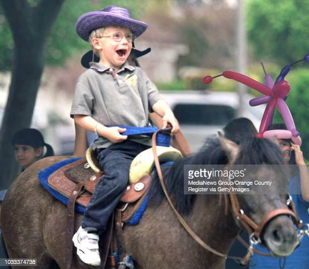 Fouryearold Jeremy Wifler of Irvine can't contain his excitment while riding a pony during a pancake breakfast to raise money for his rare and very...