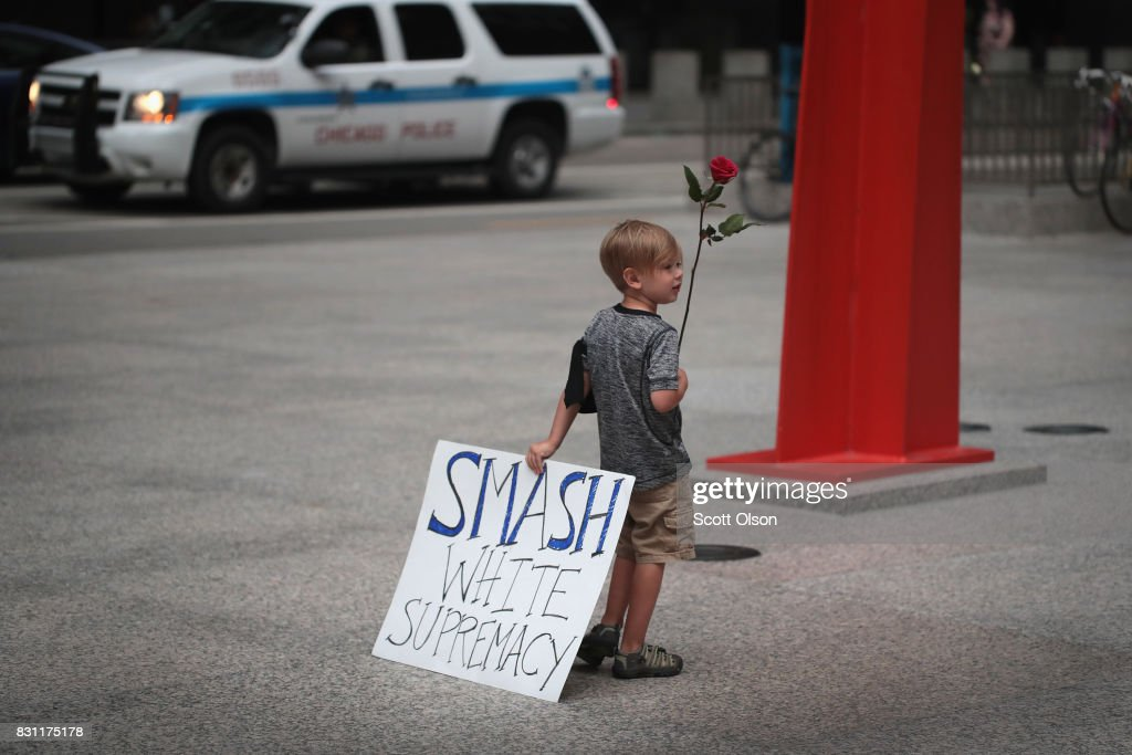 Four-year-old Leo Griffin leaves a protest against the alt-right movement held to mourn the victims of yesterdays rally in Charlottesville, Virginia on August 13, 2017 in Chicago, Illinois. One person was killed and 19 others were injured in Charlottesville when a car plowed into a group of activists who were preparing to march in opposition to a nearby white nationalists rally. Two police officers were also killed when a helicopter they were using to monitor the rally crashed.