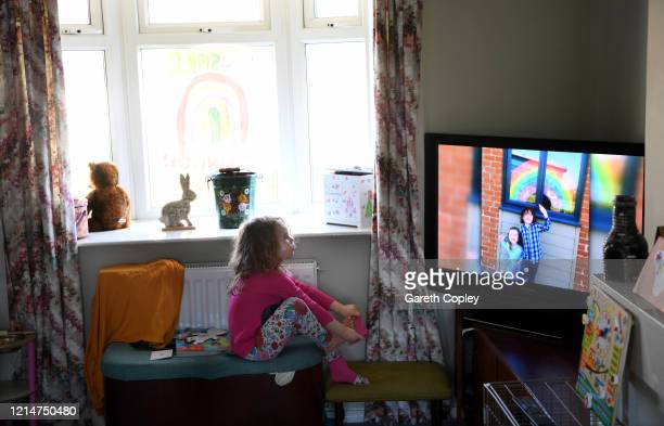 Fouryearold Lois CopleyJones who is the photographer's daughter watches television on the third day of the nationwide school closures on March 25...