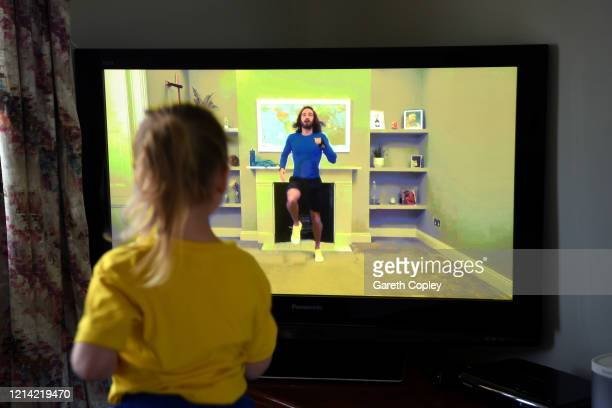 Fouryearold Lois CopleyJones who is the photographer's daughter takes part in a live streamed broadcast of PE with fitness trainer Joe Wicks on the...