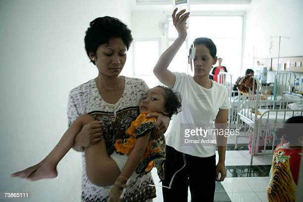 Fouryearold Putri a Dengue Fever sufferer is treated at the Tarakan General Hospital on April 12 2007 in Capital City Jakarta Indonesia Governor...
