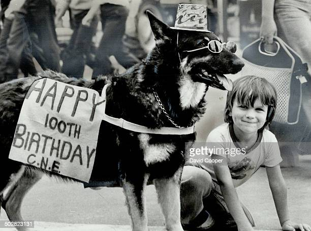 Four-Year-Old Richard Mallais says hello to his friend in dark glasses-Athena; a 16-year-old dog owned by Peter Nicholson which has performed at the...
