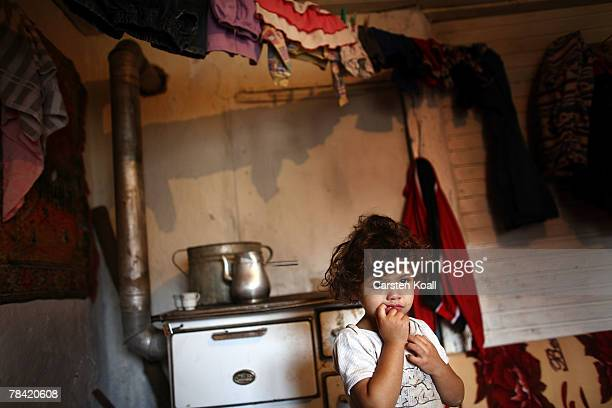 Fouryearold Roma refugee Zejnsa is shown in her family's house in the Cesmin Lug refugee camp in the Serbian district December 12 2007 in Kosovo...