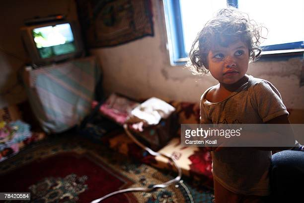 Fouryearold Roma refugee Zejnsa stands is shown in her family house in the Cesmin Lug refugee camp in the Serbian district December 12 2007 in Kosovo...