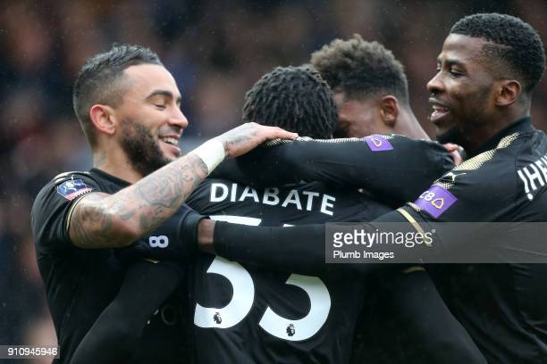 Fousseni Diabate of Leicester City celebrates with Danny Simpson Kelechi Iheanacho and Demarai Gray of Leicester City after scoring to make it 10...