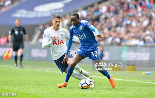Fousseni Diabate of Leicester City in action with Erik Lamela of Tottenham Hotspur during the Premier League match between Tottenham Hotspur and...