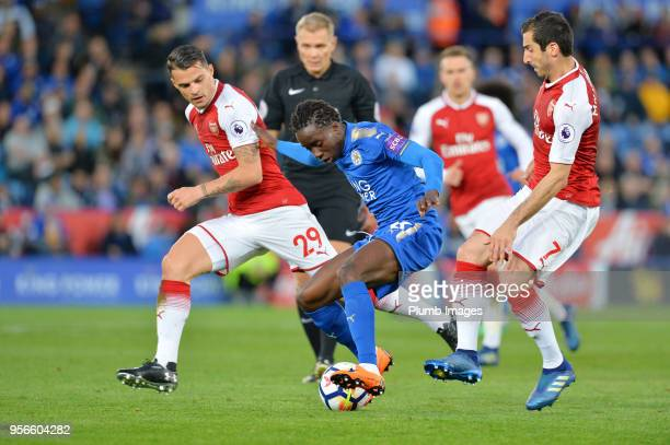 Fousseni Diabate of Leicester City in action with Granit Xhaka and Henrikh Mkhitaryan of Arsenal during the Premier League match between Leicester...