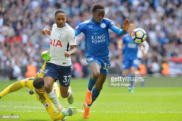Fousseni Diabate of Leicester City in action with Kyle WalkerPeters of Tottenham Hotspur during the Premier League match between Tottenham Hotspur...