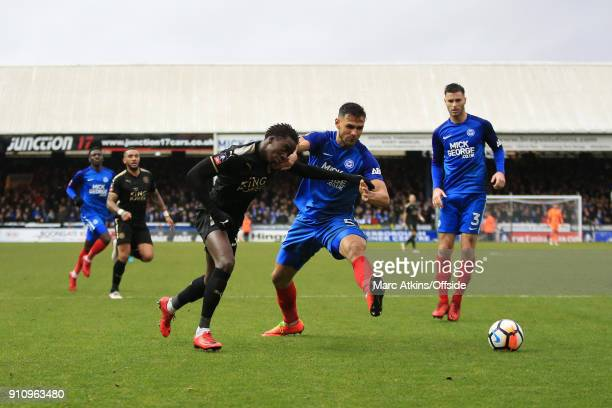 Fousseni Diabate of Leicester City in action with Ryan Tafazolli of Peterborough United during the FA Cup 4th Round match between Peterborough United...