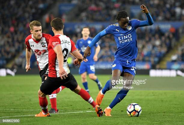 Fousseni Diabate of Leicester City is challenged by Cedric Soares of Southampton during the Premier League match between Leicester City and...