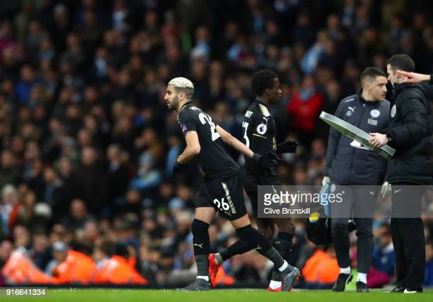 Fousseni Diabate of Leicester City is substituted for Riyad Mahrez of Leicester City during the Premier League match between Manchester City and...