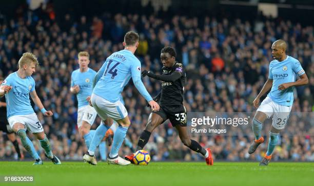 Fousseni Diabate of Leicester City runs at Aymeric Laporte of Manchester City during the Premier League match between Manchester City and Leicester...
