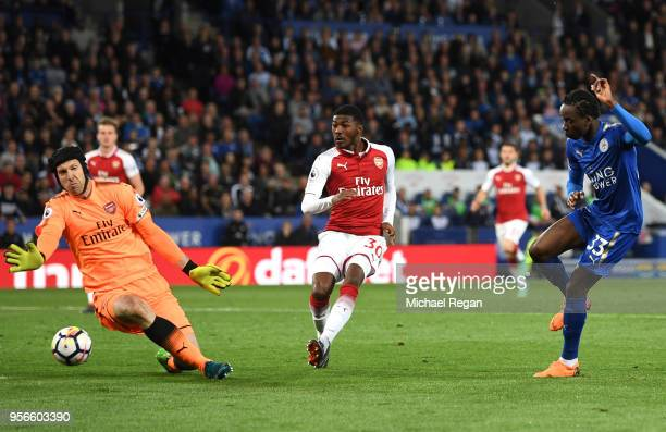 Fousseni Diabate of Leicester City shoots past Petr Cech of Arsenal during the Premier League match between Leicester City and Arsenal at The King...