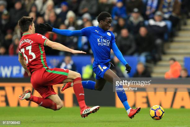 Fousseni Diabate of Leicester City shoots under pressure from Federico Fernandez of Swansea City during the Premier League match between Leicester...