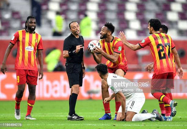 Fousseny Coulibaly of Esperance Sportive de Tunis argues with referee Abdelkader Zitouni during the FIFA Club World Cup 2019 5th place match between...