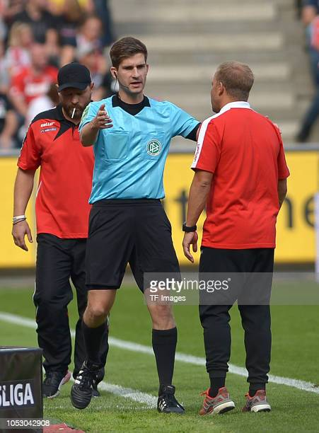 Fouth referee Markus Wollenweber speaks with Head coach Markus Anfang of Koeln during the Second Bundesliga match between 1 FC Koeln and SC Paderborn...