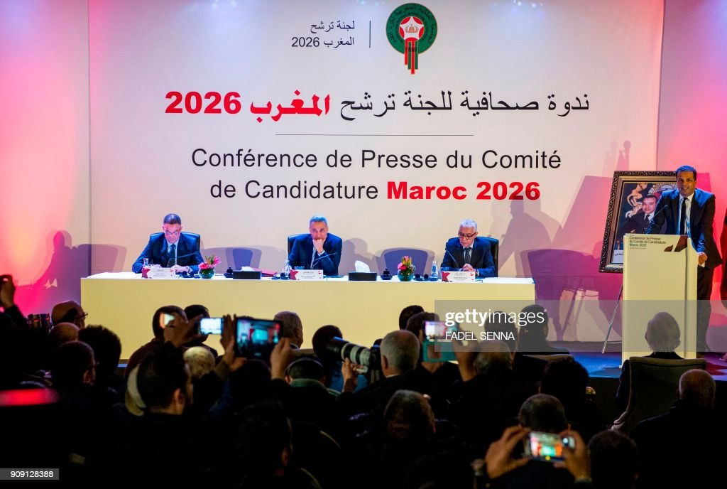 Fouzi Lekjaa (L), President of the Royal Moroccan Football Federation (FRMF), Moulay Hafid Elalamy (C), chairman of the Moroccan Committee bidding for the 2026 World Cup, and Moroccan Youth and Sport Minister Rachid Talbi Alami (2nd-R) give a press conference in Casablanca on January 23, 2018, presenting their country's pitch to host the 2026 competition. /