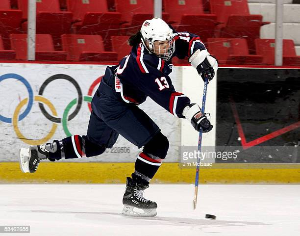 Foward Julie Chu , who was named to her second Olympic team, shoots the puck during practice at the USA Hockey National Women's Festival on August...