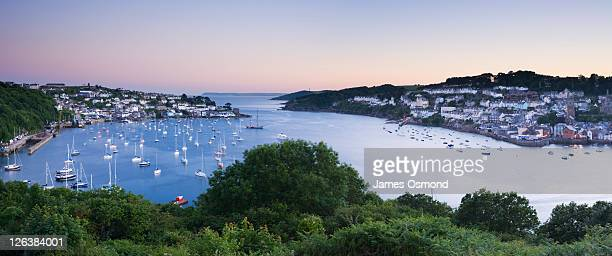 Fowey estuary at dusk with Polruan (left) and Fowey (right) from the Hall Walk. Cornwall. England. UK.