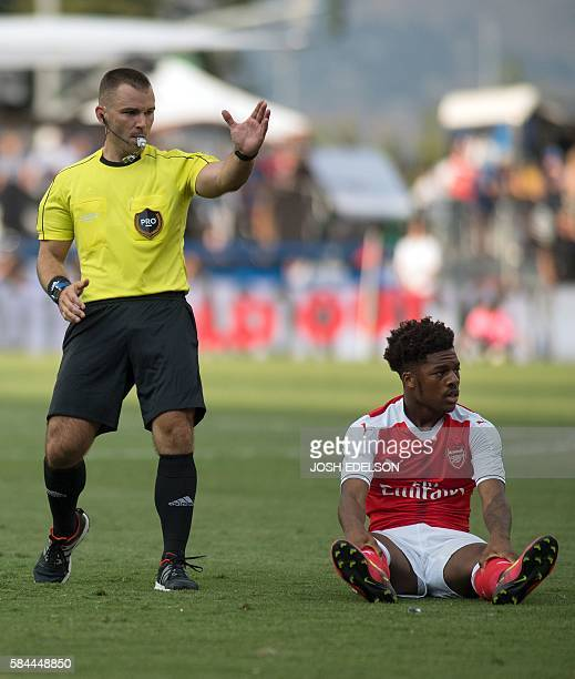 A fowl is called after Arsenal forward Chuba Akpom falls to the ground during an MLS AllStar match at Avaya Stadium in San Jose California on July 28...