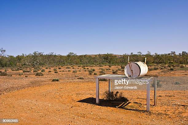 An oil drum letterbox by a desert track on an outback cattle station.
