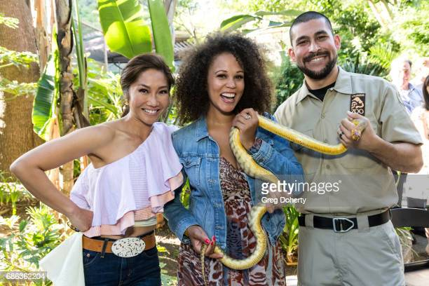 Fox 11 Julie Chang Breegan Jane and Animal Handler Francisco Moran attend the 50th Anniversary Beastly Ball at the Los Angeles Zoo on May 20 2017 in...