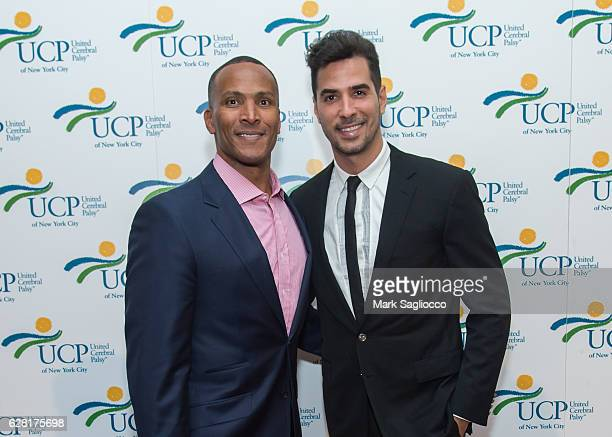 Fox 5 Meteorologist Mike Woods and Photographer Javier Gomez attend the 7th Annual UCP Of NYC Santa Project Party Auction at The Down Town...