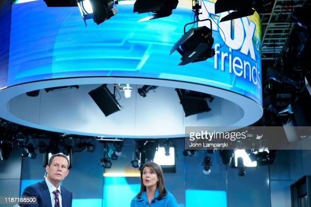 "Fox anchor Brian Kilmeade interviews former UN Ambassador Nikki Haley visits ""Fox & Friends"" at Fox News Channel Studios on November 12, 2019 in New..."