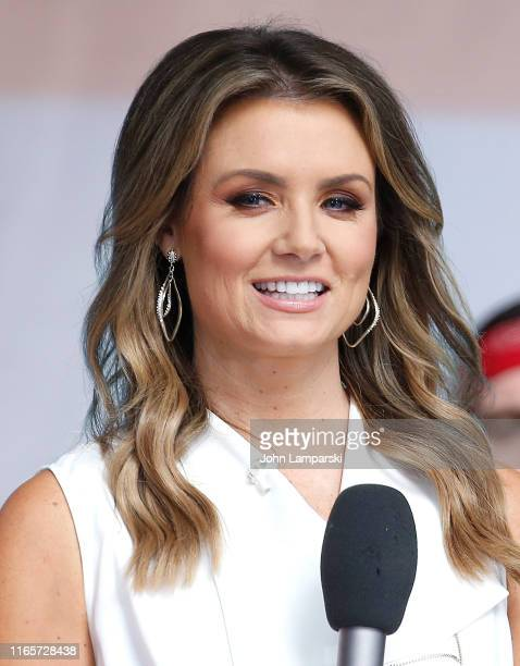Fox anchor Jillian Mele stands on stage as Justin Moore performs on FOX Friends AllAmerican Summer Concert Series on August 02 2019 in New York City